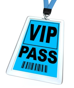 A blue badge and lanyard reading V.I.P. Pass